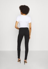Guess - CURVE  - Trousers - jet black - 2