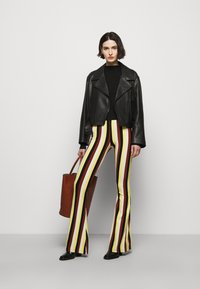 Stieglitz - BINDI FLARED - Trousers - chai - 1