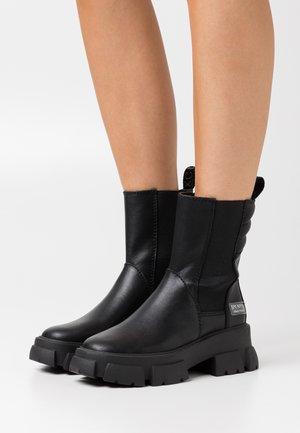 TRANSAM - Platform ankle boots - black