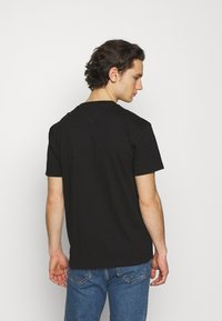 Tommy Jeans - TIMELESS TEE UNISEX - Print T-shirt - black - 2