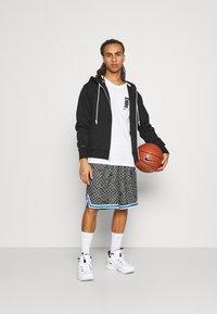 Nike Performance - SEASONAL DNA  - Sports shorts - black/light smoke grey - 1