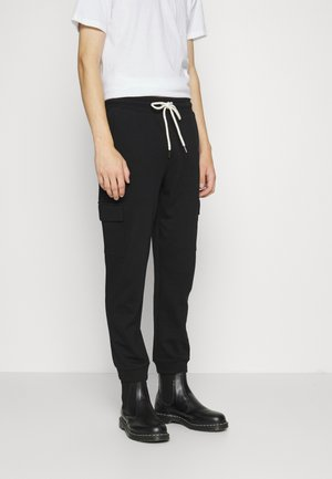 TRIPPY TRACKIE - Tracksuit bottoms - black