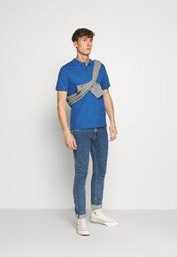 Calvin Klein - REFINED LOGO SLIM - Polo shirt - blue - 1
