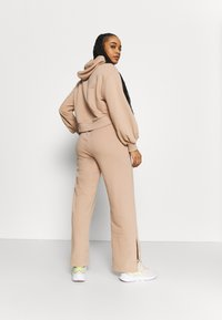 Puma - HER WIDE PANTS - Tracksuit bottoms - brush - 2