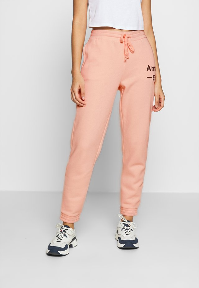 GRAPHIC JOGGER - Verryttelyhousut - peach