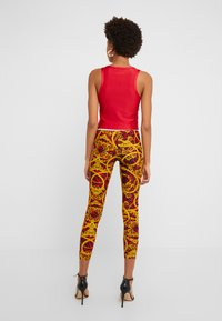 Versace Jeans Couture - LADY FUSEAUX - Leggings - racing red - 2