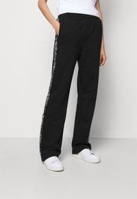 HUGO - NENNIFER - Pantalones deportivos - black - 0