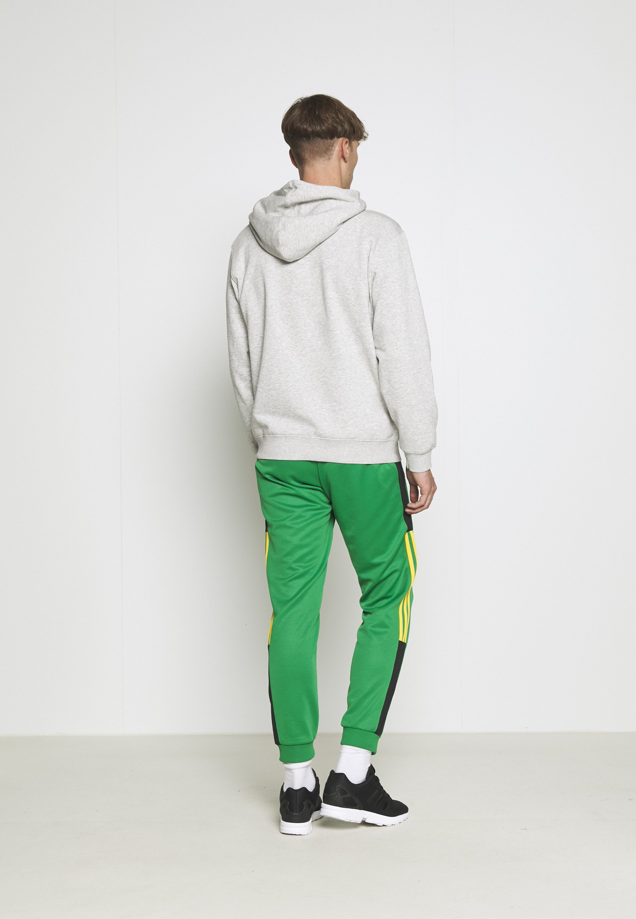 adidas Originals CLASSICS  - Tracksuit bottoms - green/black I1XNA