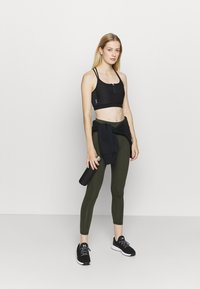 ONLY Play - ONPALANI SPORTS BRA - Medium support sports bra - black/white - 1