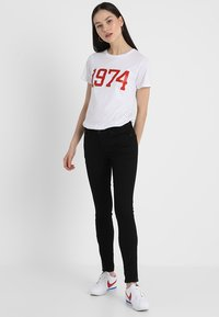 Tommy Jeans - MID RISE NORA - Jeansy Skinny Fit - dana black - 1