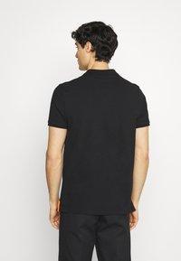 Schott - PSMILTON - Polo shirt - black/orange - 2