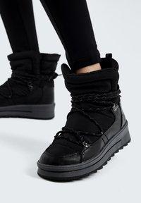 OYSHO - Lace-up ankle boots - black - 0