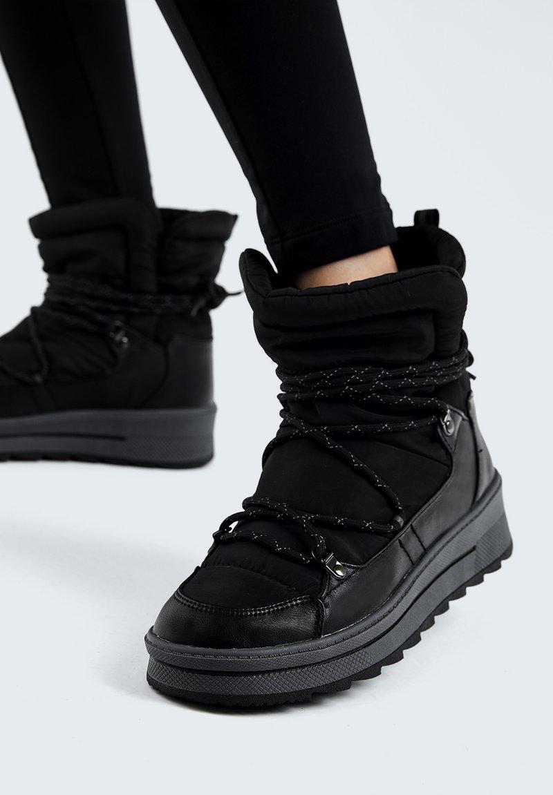 OYSHO - Lace-up ankle boots - black