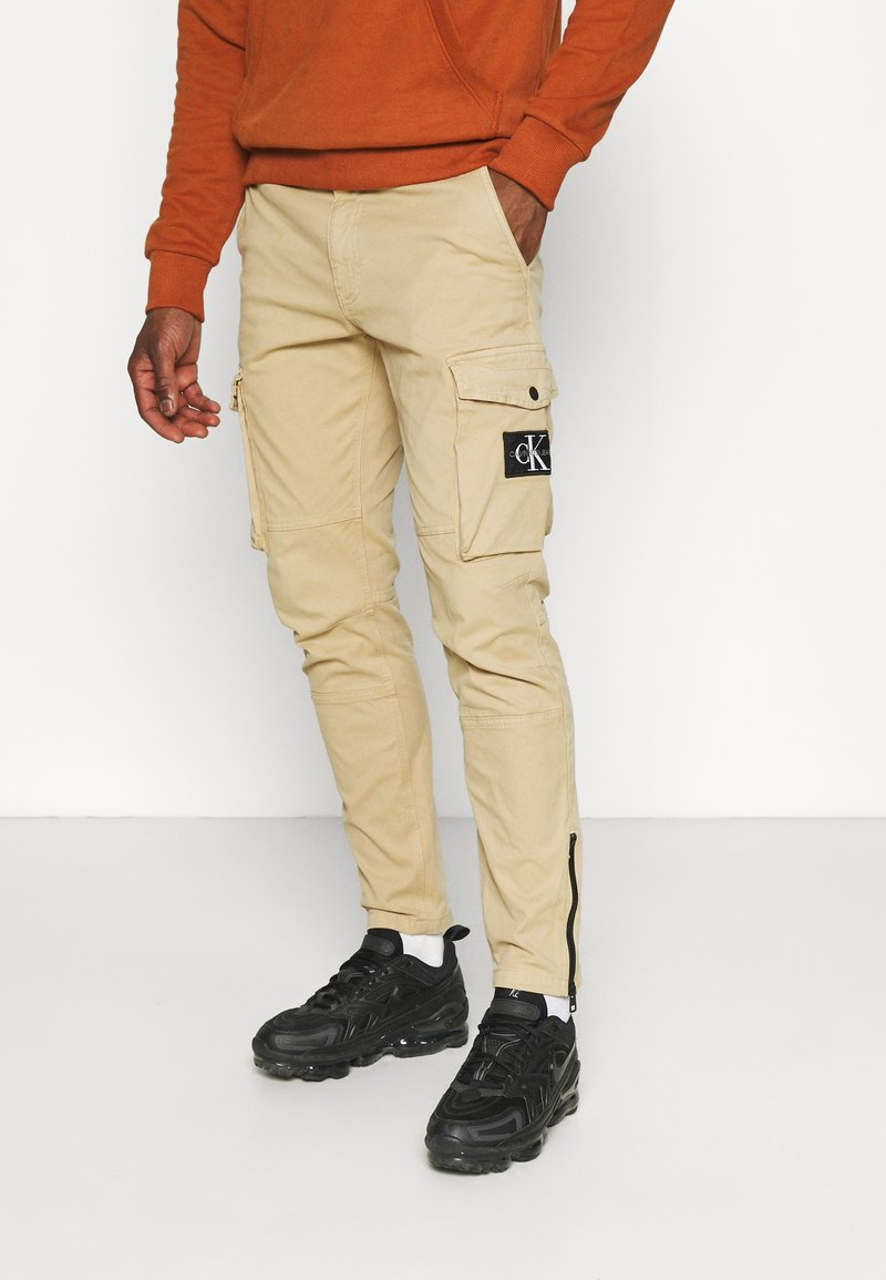 Calvin Klein Jeans - WASHED PANT - Cargo trousers - beige