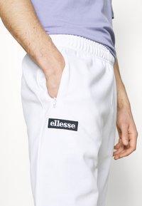 Ellesse - BERTONI TRACK PANT - Träningsbyxor - white - 4