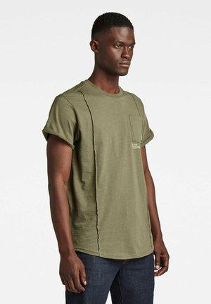 LASH POCKET BACK GRAPHIC - Print T-shirt - green