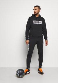 Nike Performance - FC HOODIE - Felpa con cappuccio - black - 1