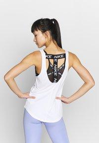 Nike Performance - DRY VICTORY ELASTIKA TANK - Camiseta de deporte - white/black - 2