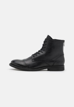 BOOSTER - Lace-up ankle boots - black