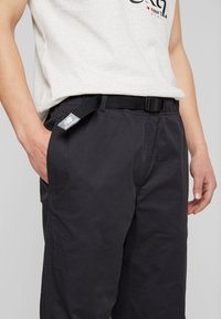 New Balance - ATHLETICS PANT - Trousers - black - 4