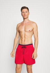 Tommy Hilfiger - LOGOLINE MEDIUM DRAWSTRING - Swimming shorts - red - 0
