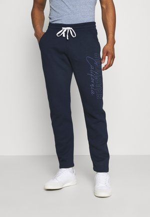 HERITAGE TECH - Tracksuit bottoms - navy