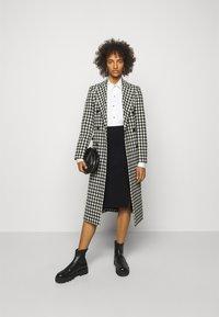 DESIGNERS REMIX - MANDY SLIT SKIRT - Pencil skirt - black - 1