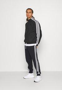 adidas Performance - PANT - Tracksuit bottoms - black - 1
