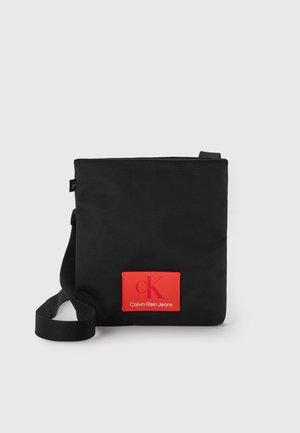 FLATPACK UNISEX - Across body bag - black