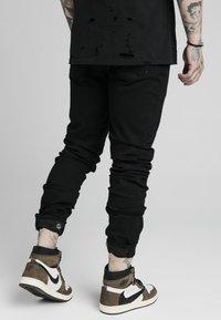 SIKSILK - ELASTICATED STRAP CUFF - Jeans slim fit - black - 4