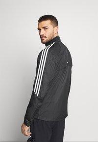 adidas Performance - MARATHON - Löparjacka - black/white - 2