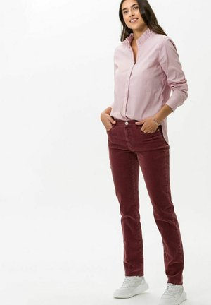 STYLE CAROLA - Trousers - raisin
