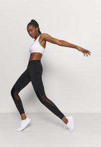 adidas Performance - ASK BRA - Medium support sports bra - white - 1