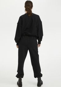 Gestuz - CHRISDAGZ - Tracksuit bottoms - black - 2