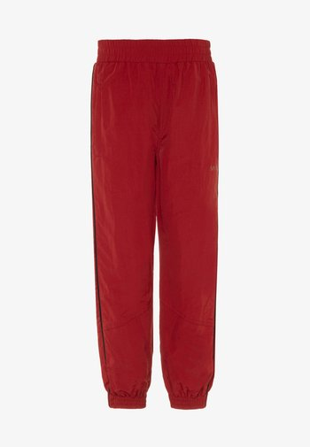 ANOMI - Tracksuit bottoms - dark red