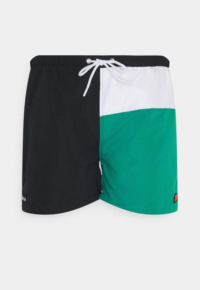 DEWI - Swimming shorts - black/green