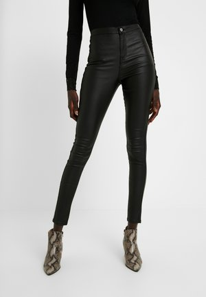 HIGH WAISTED COATED - Pantalones - black