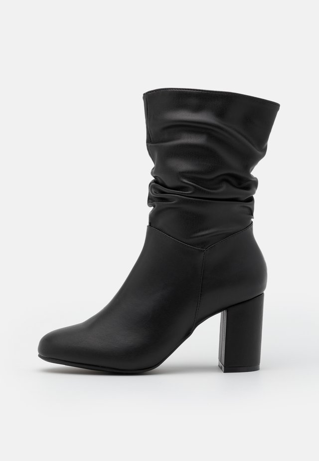 EXISTANCE - Classic ankle boots - black