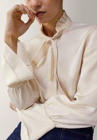Massimo Dutti - MIT VOLANT - Button-down blouse - white - 5