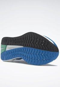 Reebok - FLOATRIDE ENERGY SYMMETROS SHOES - Stabilty running shoes - blue - 7