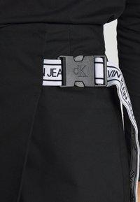 Calvin Klein Jeans - BUCKLE LOGO STRAP - Mini skirt - black - 4