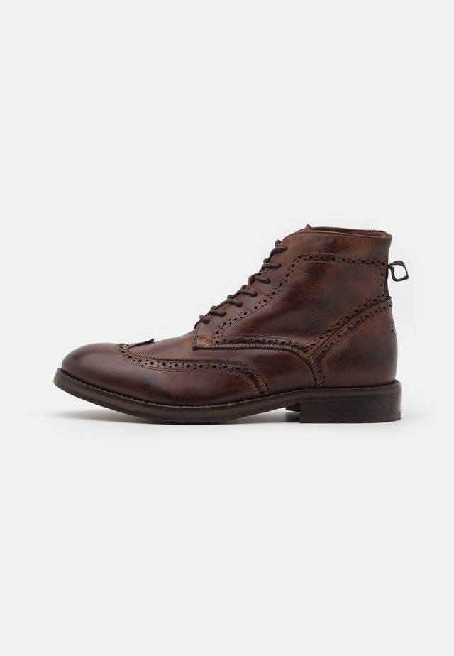 ANDERSON - Lace-up ankle boots - brown