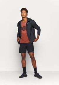 Nike Performance - RISE TANK - Sports shirt - claystone red/black - 1
