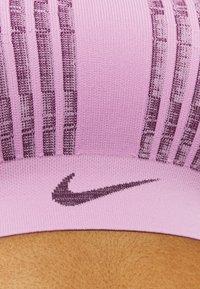Nike Performance - FE/NOM FLYKNIT BRA - Medium support sports bra - beyond pink/bordeaux - 5