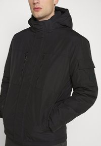Jack & Jones - JJFERGUS JACKET - Regenjas - black - 5