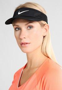 Nike Performance - WOMEN AEROBILL FEATHERLIGHT VISOR ADJUSTABLE - Cap - black/white - 1