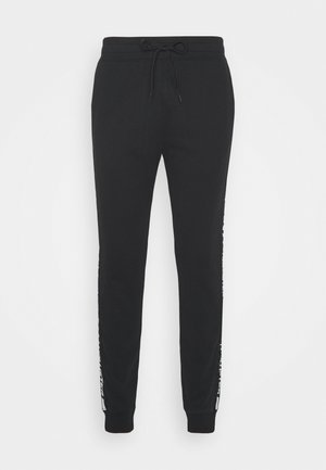 TERRY JOGGER - Tracksuit bottoms - black