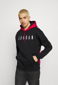 Jordan - JUMPMAN AIR - Sweatshirt - black/gym red - 0
