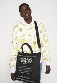 Versace Jeans Couture - UNISEX - Tote bag - black - 1