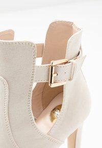 Buffalo - JONA - Kotníková obuv na vysokém podpatku - pastel/beige - 2